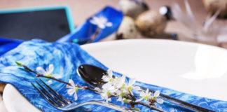 Easter Table Setting With Blue Textile Napkin, Blossom Branch And Quail Eggs