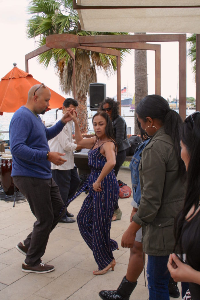 Guests Dance To The Music During Fuego¹s Monthly Latin Brunch Series Stop In Mexico Next Destination El Salvador On June 25 Photo One