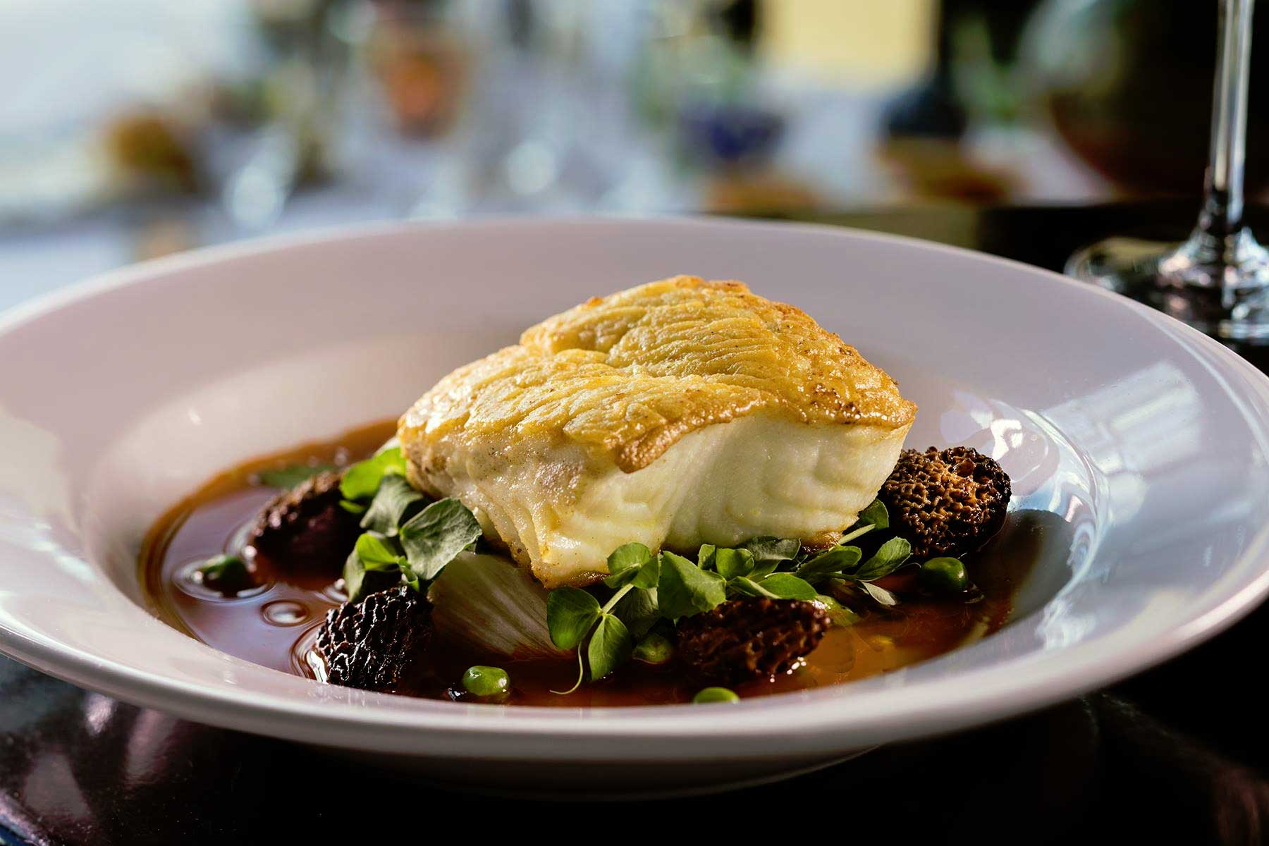 Wildfish Seafood Grille Roasted Halibut Filet With Morels And Spring Peas